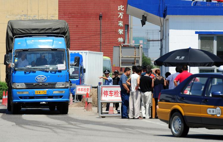 Truckers get their registration checked. In some areas in China, drivers are forced to pay fines that sometimes bought exemption from traffic law violation for several months. (Frederic J. Brown/AFP/Getty Images)