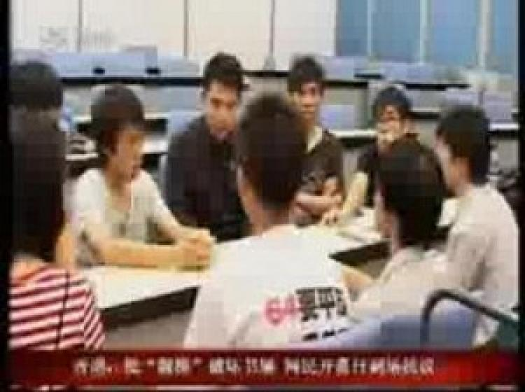 During a talk show broadcast by Shenzhen Satellite TV, a man is seen wearing a T-shirt with the words 'Vindicate June 4' on the back. (TV screenshot)