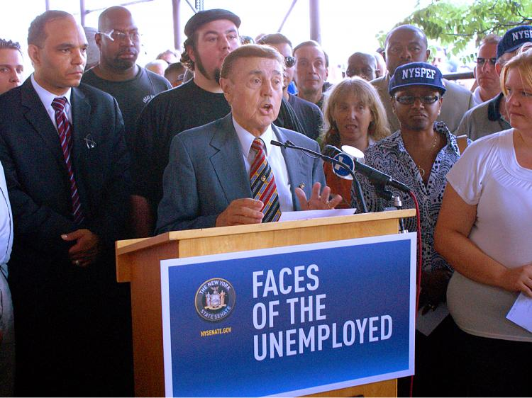 UNEMPLOYED: State Senator George Onorato is joined by a crowd of unemployed New Yorkers and other senators in hope of increasing the states weekly unemployment benefits. (Diana Hubert/The Epoch Times)