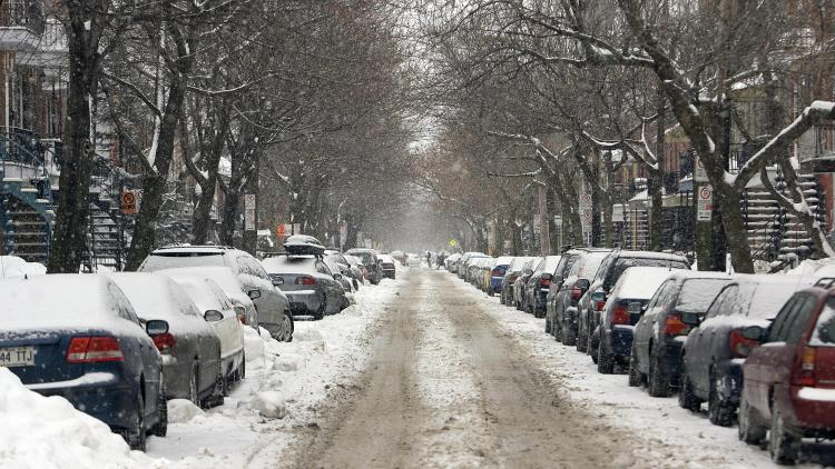 A street in the Plateau Mont-Royal district of Montreal is covered with snow in March 2008. By mid-March last winter Montreal had accumulated some 350 centimetres (11.5 feet) of snow. (David Boily/AFP/Getty Images)