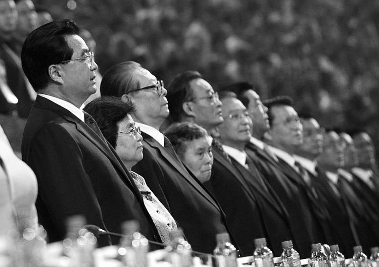 Jiang Zemin (3rd from left), former supreme leader of the Chinese Communist Party (CCP), flanked by other top regime leaders and their wives, at the opening of the 2008 Beijing Paralympic Games. Jiang is said to be hospitalized and approaching death, though other such rumors have circulated in the past. (Liu Jin/AFP/Getty Images)
