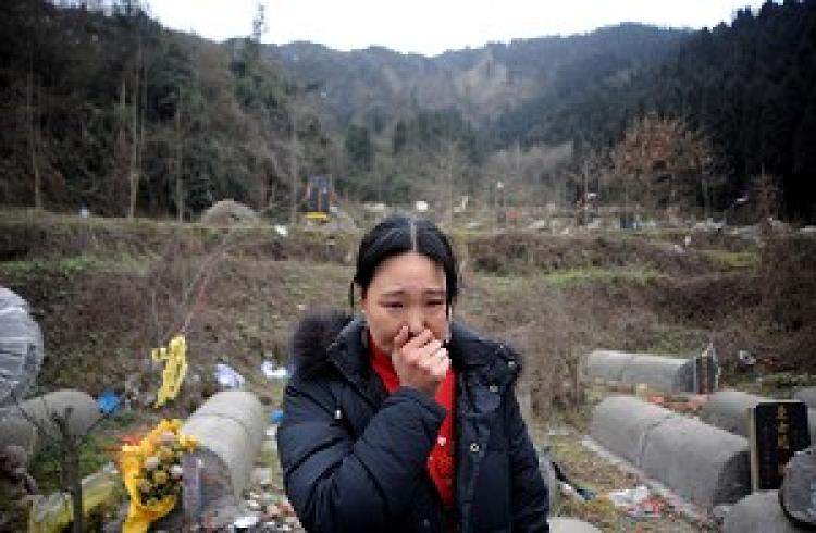 Survivors of Wenchuan Quake cry over the loss of their families. (Getty Images)