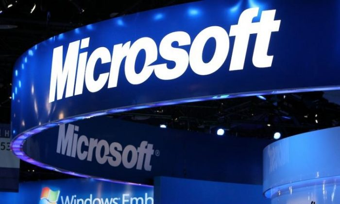 The Microsoft logo is displayed over the Microsoft booth at the 2010 International Consumer Electronics Show. (Justin Sullivan/Getty Images)