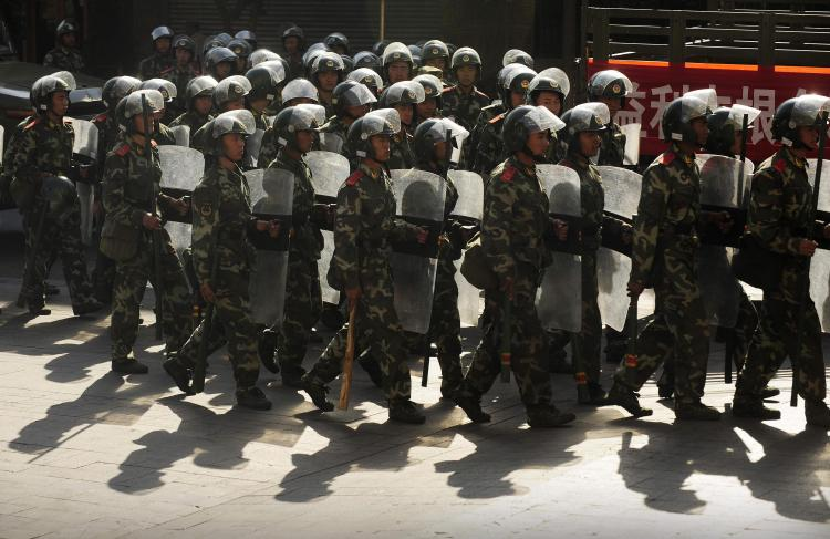 Chinese paramilitary police march through a street in Urumchi, in China's farwest Xinjiang region, on July 9, 2009. (Peter Parks/AFP/Getty Images)