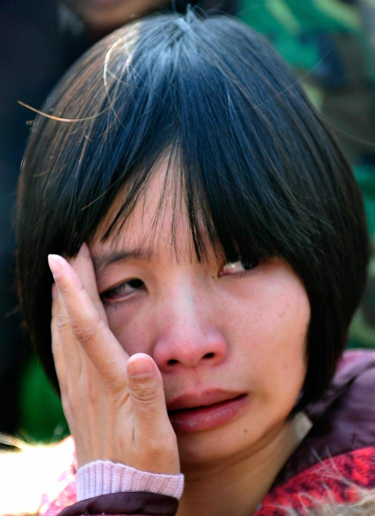 Zeng Jinyan, the wife of human rights activist Hu Jia weeps outside a courthouse after her husband was sentenced to three years jail in April this year.   (Teh Eng Koon/AFP/Getty Images)