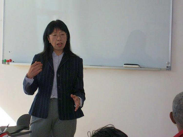 Professor Zhu Liqun, assistant president of the China Foreign Affairs University, spoke to Caribbean journalists on Oct. 13 last year. She said China is a developing country and it will be paying more attention to balancing the economy to help the people. (Courtesy of Gwyneth Harold)