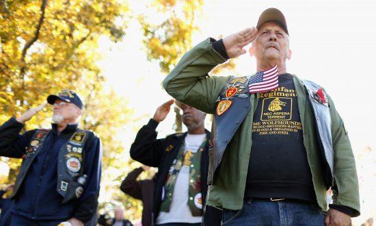 Vietnam War veterans salute at the Vietnam Veterans Memorial on the  National Mall in Washington on fa4fc73e4