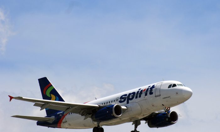 A Spirit Airlines plane approaches Chicago O'Hare International Airport in June   2015. (Bill Montgomery/Houston Chronicle via AP)