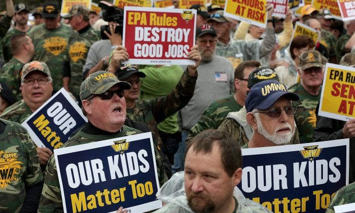 Members of the United Mine Workers of America rally outside of the headquarters of the Environmental Protection Agency in Washington, D.C., on Oct. 7, 2014. The rally was held to protest regulations proposed by the Environmental Protection Agency (EPA) that could impact the nation's coal industry and coal-related jobs. (Win McNamee/Getty Images)