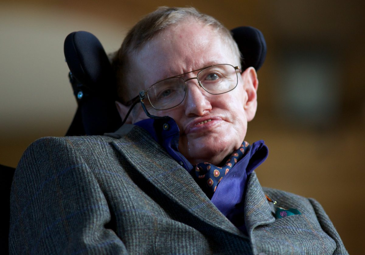 "Theoretical physicist Stephen Hawking poses for a picture ahead of a gala screening of the documentary ""Hawking,"" a film about the scientist's life, at the opening night of the Cambridge Film Festival in Cambridge, England, on Sept. 19, 2013. (Andrew Cowie/AFP/Getty Images)"