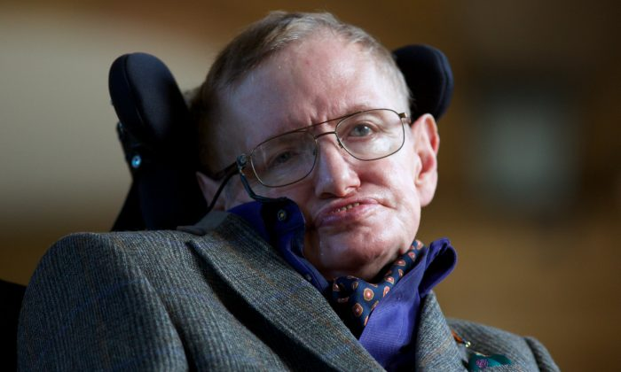 """Theoretical physicist Stephen Hawking poses for a picture ahead of a gala screening of the documentary """"Hawking,"""" a film about the scientist's life, at the opening night of the Cambridge Film Festival in Cambridge, England, on Sept. 19, 2013. (Andrew Cowie/AFP/Getty Images)"""