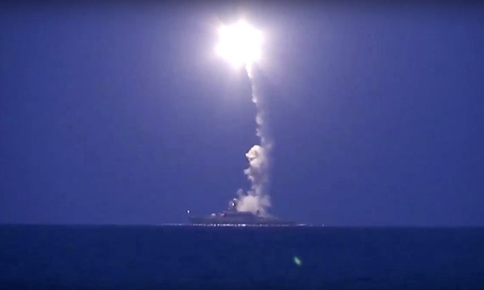 A Russian navy ship launches a cruise missile in the Caspian Sea on Oct. 7, 2015. (Russian Defense Ministry Press Service via AP)