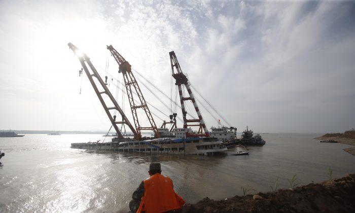 Rescuers work to raise the capsized ship Dongfangzhixing in the Yangtze River in Jingzhou, China,  on June 5, 2015. (ChinaFotoPress/ChinaFotoPress via Getty Images)
