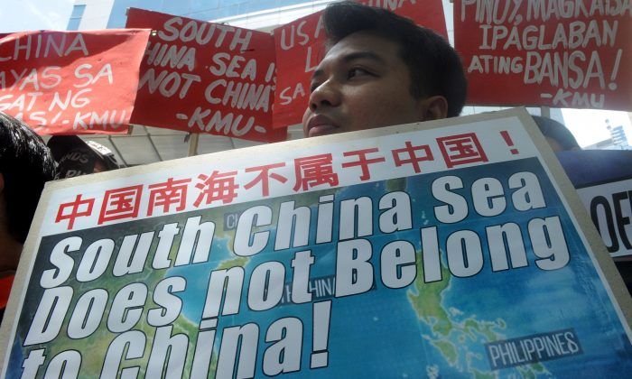 Activists hold a protest in front of the Chinese Consular Office in Manila, Philippines, on July 7, 2015, against China's claims, construction activities, and military build-up on the South China Sea. (Jay Directo/AFP/Getty Images)