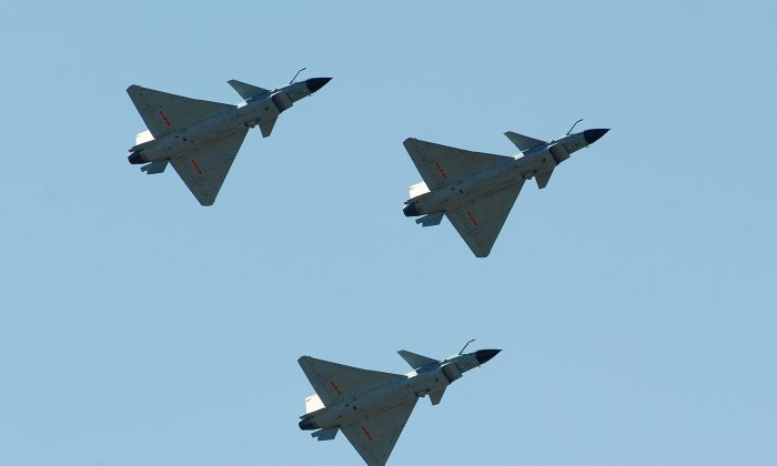 Chinese J-10 fighter jets fly on display over the Yangcun Air Force base of the People's Liberation Army Air Force in Tianjin on April 13, 2010. (FREDERIC J. BROWN/AFP/Getty Images)