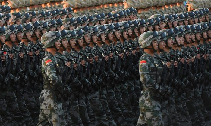 Chinese soldiers conduct a practice at dawn ahead of a military parade later in the morning at Tiananmen Square in Beijing on Sept. 3, 2015. (Greg Baker/AFP/Getty Images)