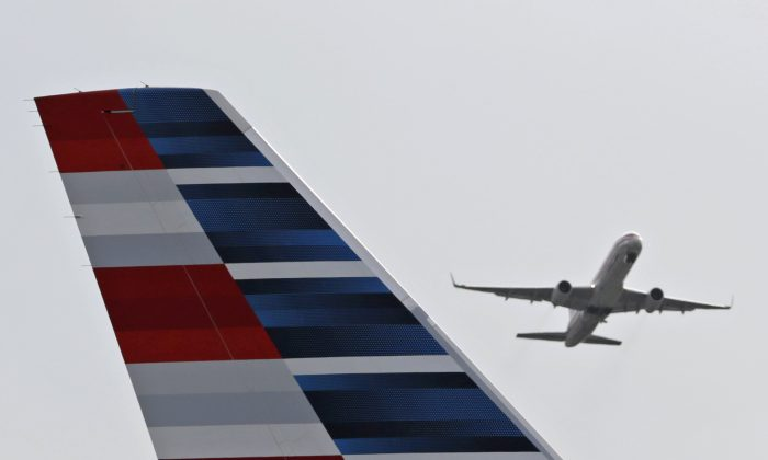 In this May 27, 2014 file photo, an American Airlines passenger plane takes off from Miami International Airport in Miami. (AP Photo/Alan Diaz, File)