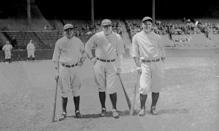 Home run king Babe Ruth of the New York Yankees, center, is seen with teammates Tony Lazzeri, left, and Lou Gehrig, right, June 1927 in New York. (AP Photo)