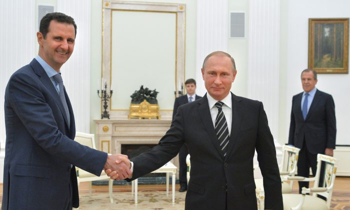 Russian President Vladimir Putin (C), Syrian President Bashar Assad (L), and Russian Foreign Minister Sergey Lavrov (R) at the Kremlin in Moscow, Russia. (Alexei Druzhinin/RIA-Novosti via AP)
