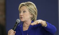 Clinton Questions Plans for Health Insurers to Merge