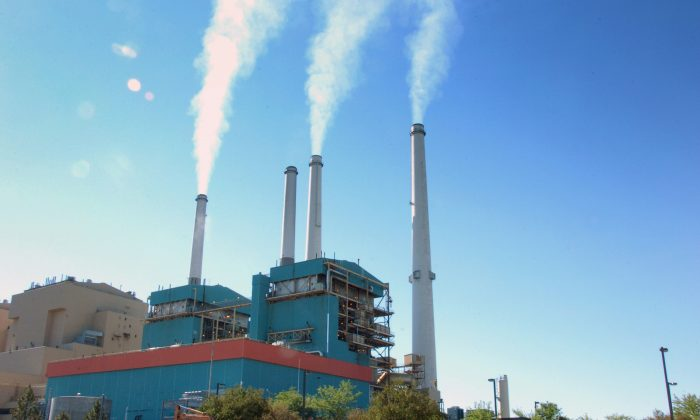 Smoke rises from the Colstrip Steam Electric Station, a coal burning power plant in in Colstrip, Mont., on July 1, 2013. (AP Photo/Matthew Brown)