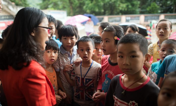 Children in the town of Xianghe, in southern China's Guangxi on June 19, 2015. (JOHANNES EISELE/AFP/Getty Images)