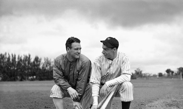 Lou Gehrig (L) gets something like a smile from rookie sensation Joe DiMaggio during spring training in St. Petersburg, Fla., March 8, 1936. DiMaggio, purchased from the San Francisco Seals, had earned a reputation for being shy and reserved since joining the Yankees in Florida. (AP Photo)