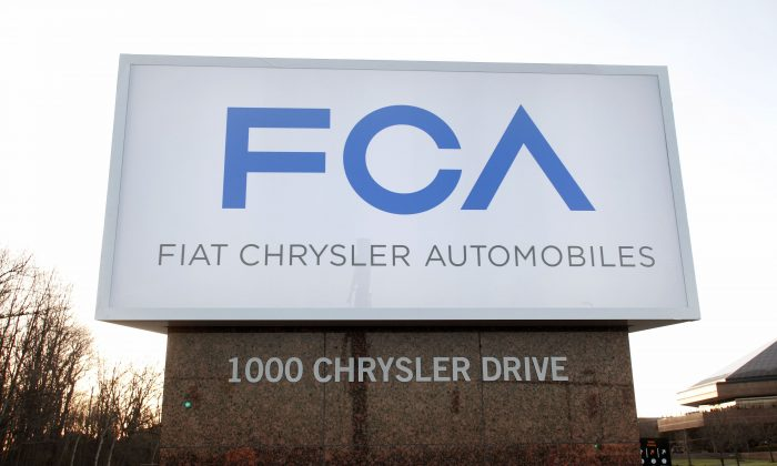The new Fiat Chrysler Automobiles (FCA) Group sign is shown at the Chrysler Group headquarters in Auburn Hills, Michigan, on May 6, 2014. (Bill Pugliano/Getty Images)