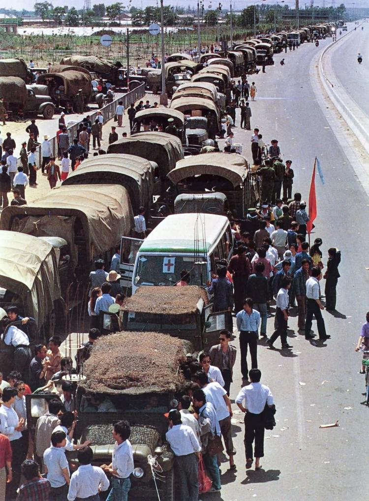 May 21st. A convoy of some 200 army vehicles sit idle after demonstrators blocked the road at Feng Tai 15 miles southwest of Beijing. (64memo.com)