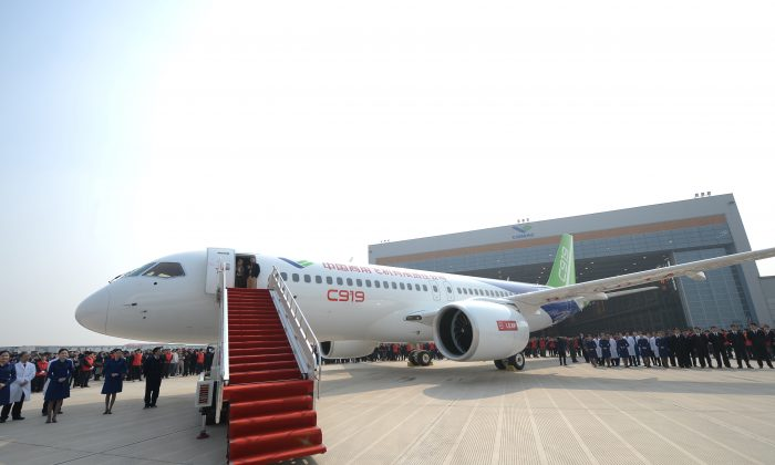 China's first self-developed large passenger jetliner C919 is presented after it rolled off the production line at Shanghai Aircraft Manufacturing Co., Ltd in Shangha on Nov. 2, 2015. (ChinaFotoPress/Getty Images)