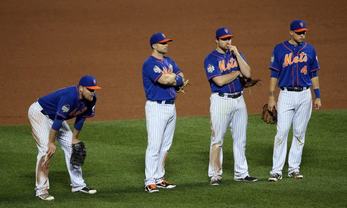 Mets infielders (L-R) Lucas Duda, David Wright, Daniel Murphy, and Wilmer Flores came up short in their bid to win the World Series but their run isn't over. (Doug Pensinger/Getty Images)