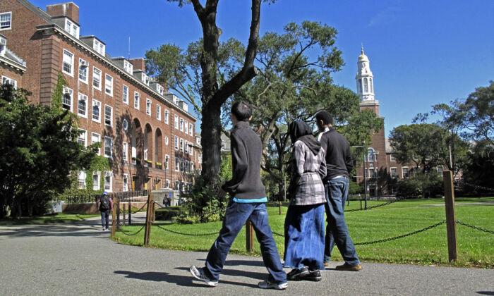 People walk on the campus of Brooklyn College in the Brooklyn, New York, on Oct. 7, 2011. (AP Photo/Bebeto Matthews)