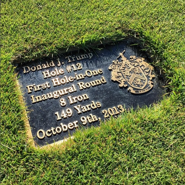 """Donald Trump provided the first """"ace"""" at Ferry Point with his hole-in-one at the 12th. ()"""