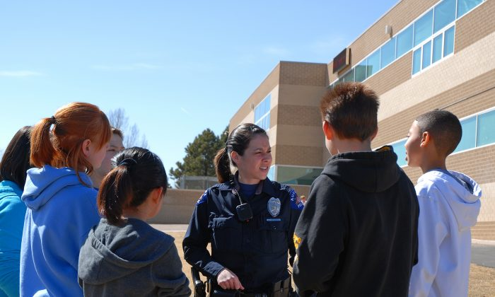 School Resource Officer with students. (Courtesy of Aurora City, Colorado)