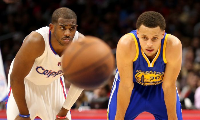 Chris Paul (L) and Stephen Curry are two of the best point guards in the NBA. (Stephen Dunn/Getty Images)