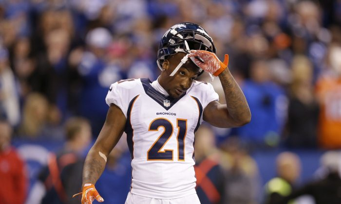 Denver Broncos cornerback Aqib Talib (21) takes off his helmet during the first half of an NFL football game against the Indianapolis Colts, Sunday, Nov. 8, 2015, Indianapolis. (AP Photo/Michael Conroy)