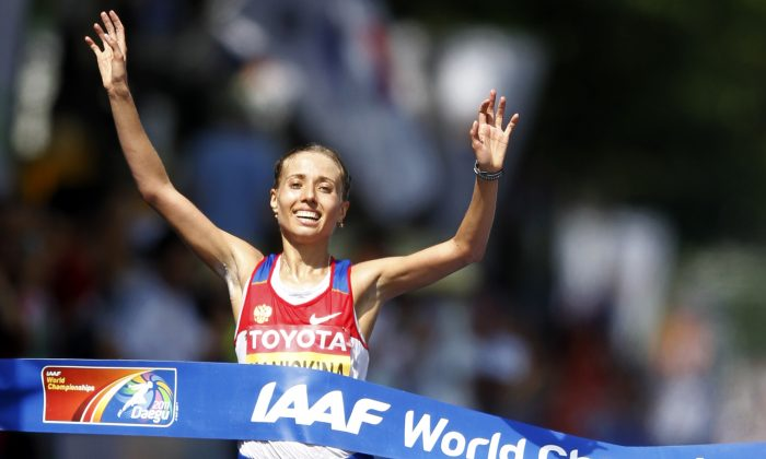 Russia's Olga Kaniskina crosses the finish line to win the Women's 20km Race Walk at the World Athletics Championships in Daegu, South Korea, Aug. 31, 2011.  (AP Photo/Lee Jin-man, file)