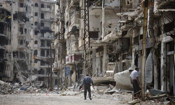A man walks through a devastated part of Homs, Syria, on June 5, 2014. (AP Photo/Dusan Vranic)