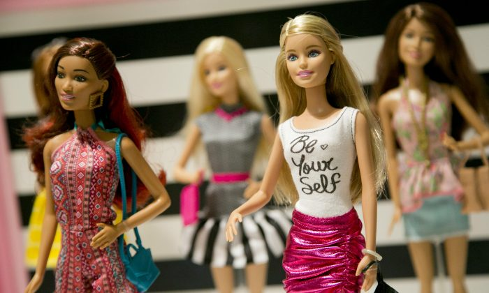 "Barbie Fashionista Dolls from Mattel are displayed at the TTPM Holiday Showcase in New York on Sept. 29, 2015. The U.S. toy industry is expected to have its strongest year in over a decade. Richard Dickson, Mattel's president and chief operating officer, told investors that he's seeing ""a lot of positive momentum"" coming from its two biggest brands—Barbie and Fisher-Price. (AP Photo/Mark Lennihan)"