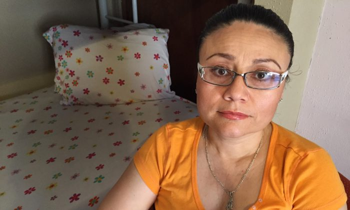 In this Thursday, July 30, 2015 photo, Rosa Robles Loreto sits in her small room at Southside Presbyterian Church in Tucson, Ariz. (AP Photo/Astrid Galvan,File)