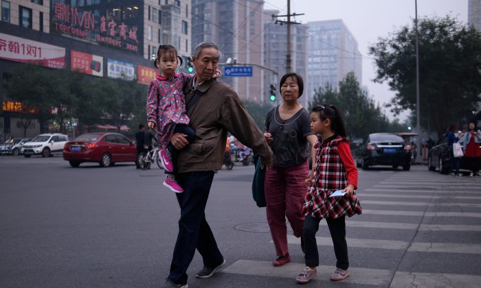 A family in Beijing on Oct. 6, 2015. (Ed Jones/AFP/Getty Images)