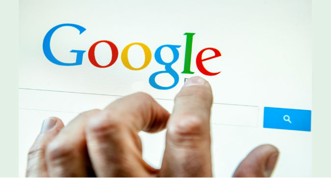 A person prepares to search the internet using the Google search engine. (PHILIPPE HUGUEN/AFP/Getty Images)