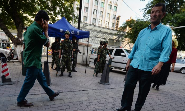 Chinese paramilitary police stand guard in the Muslim Uyghur minority area of Urumqi, Xinjiang Province, China on June 30, 2013. (Mark Ralston/AFP/Getty Images)