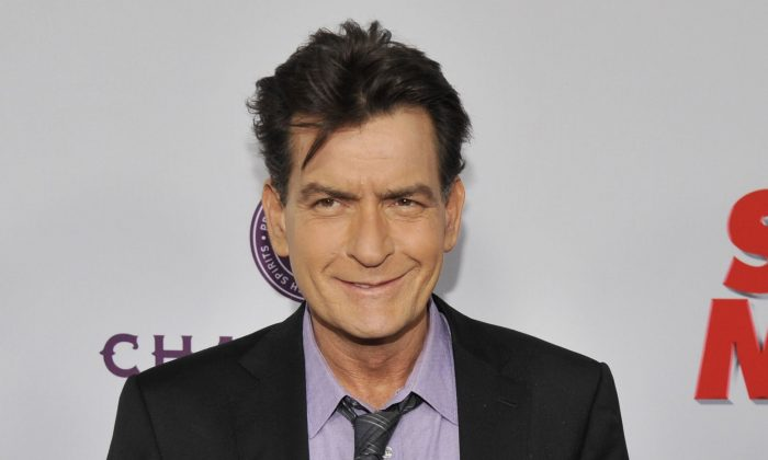 "In this April 11, 2013 file photo, Charlie Sheen, a cast member in ""Scary Movie V,"" poses at the Los Angeles premiere of the film at the Cinerama Dome in Los Angeles. (Photo by Chris Pizzello/Invision/AP, file)"