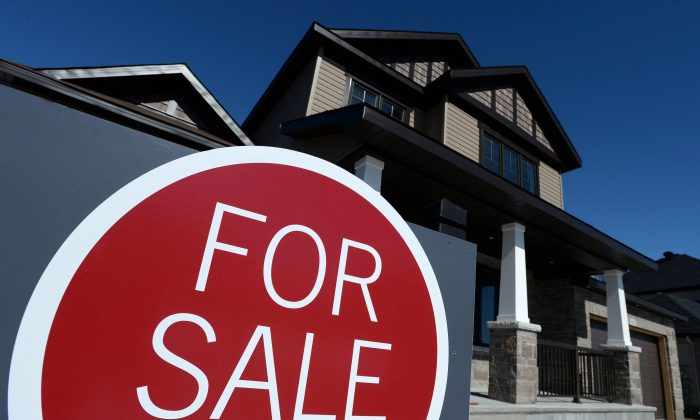A sign advertises a new home for sale in Carleton Place, Ontario in this file photo. At the national level, home sales have almost reached a peak for six years. (The Canadian Press/Sean Kilpatrick)