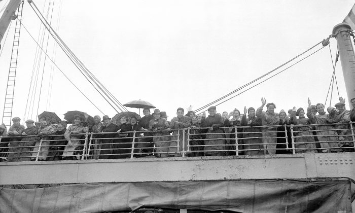 Jewish refugees from Britain get their first glimpse of North America as they dock at Halifax, Nova Scotia, Canada, on June 19, 1940. They are enroute to New York City to make a new life. (AP Photo)