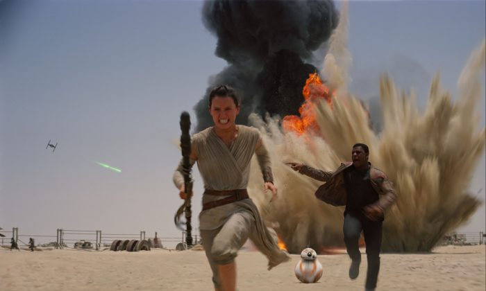 """This photo provided by Disney shows Daisey Ridley as Rey (L) and John Boyega as Finn, in a scene from the new film, """"Star Wars: Episode VII—The Force Awakens,"""" directed by J.J. Abrams. (Film Frame/Disney-Lucasfilm via AP)"""
