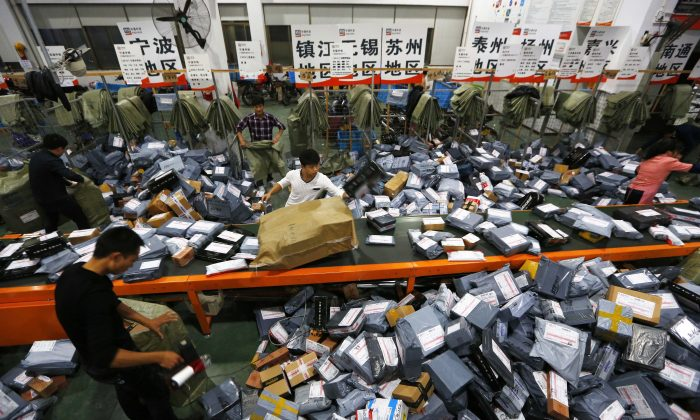 An mail crew deals with express packages at an assembly line on Nov. 12, 2014 in Wenzhou, Zhejiang, during Singles Day. (ChinaFotoPress/ChinaFotoPress via Getty Images)