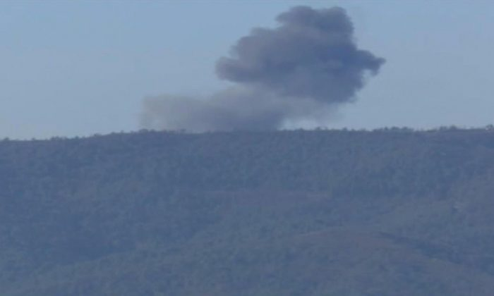 This frame grab from video by Haberturk TV, shows smoke from a Russian warplane after crashing on a hill as seen from Hatay province, Turkey, Tuesday, Nov. 24, 2015. (Haberturk TV via AP)