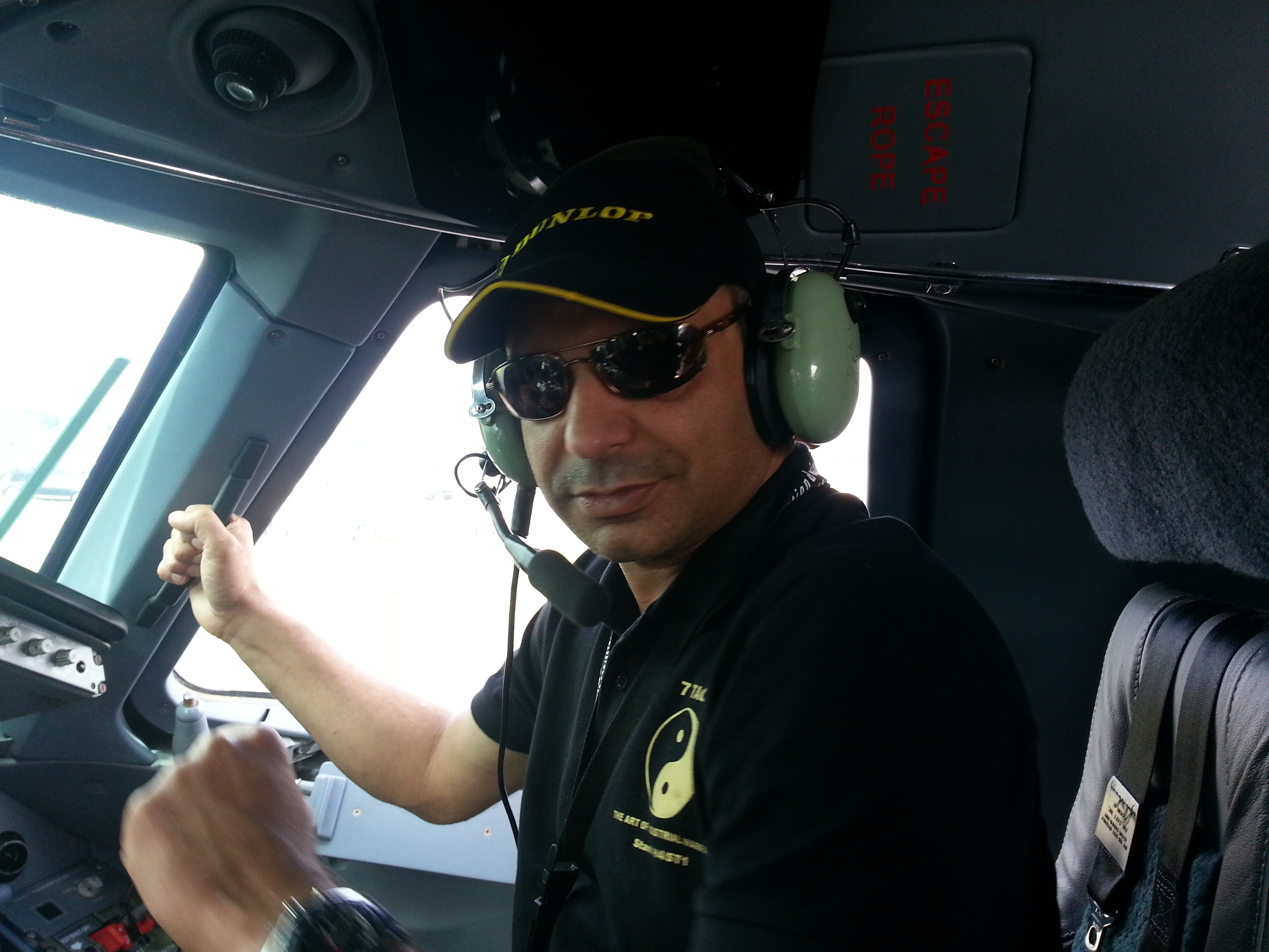 Amar Manzoor, founder of 7Tao, sits in the cockpit of an Embreaer plane. Manzoor has developed a to train businesses on industrial warfare. (Amar Manzoor)